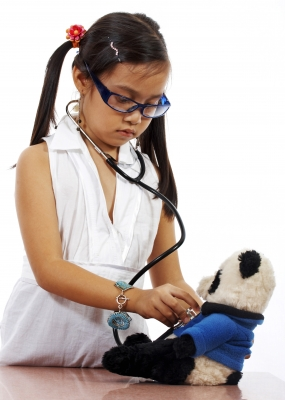 child playing doctor with teddy.jpg
