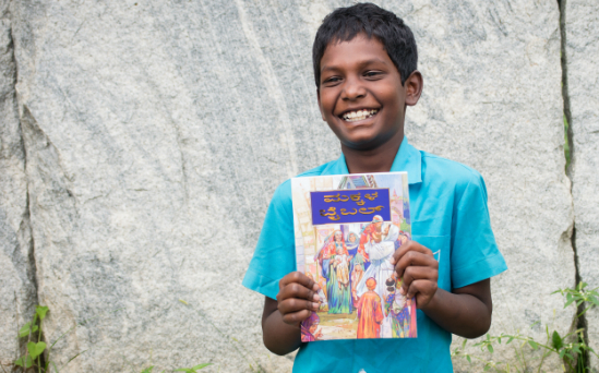 Children like Dharson are so excited to receive God's Word.