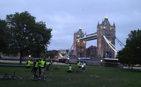 Nightriders taking a break in front of London Bridge
