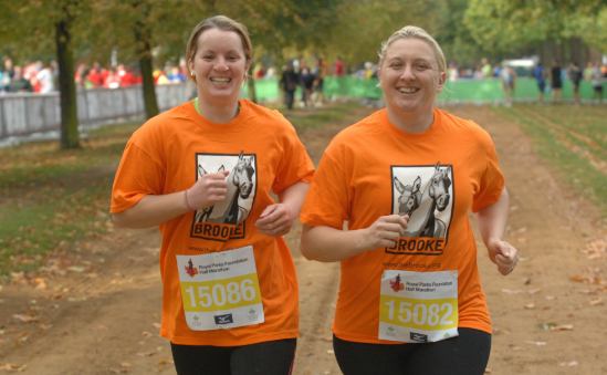 Two Brooke runners warming up for the Royal Parks