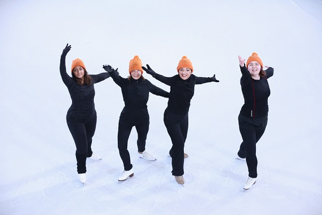 Synchronised skaters perform for Woolly Hat Day.jpg