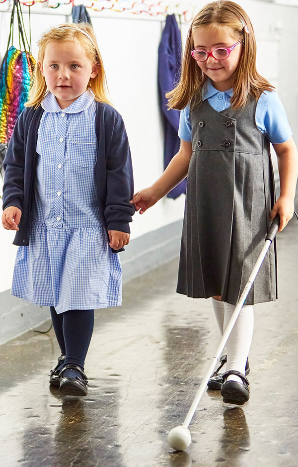 nell-at-school-with-her-cane-and-her-friend.jpg